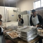 Photo of volunteers preparing Thanksgiving dinners.