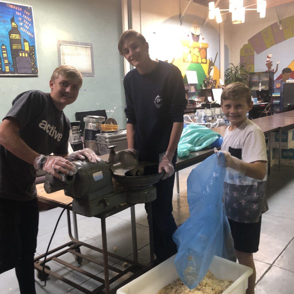 Photo of volunteers preparing Thanksgiving dinners.